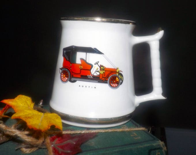 Mid-century Prince William Pottery England 22K-gold edged collectible auto car tankard   stein featuring a vintage, red Austin car.
