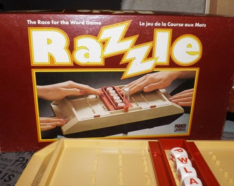 Vintage (1981) Razzle board game published in Canada by Parker Brothers.  Complete.