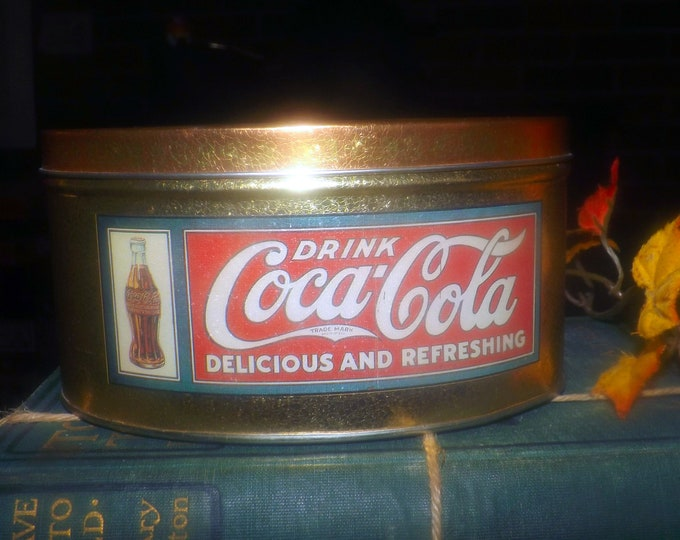 Vintage (1990s) Coke | Coca Cola tin. Gibson Girl with wide-brim hat. Drink Coca-cola delicious and refreshing.