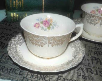 Early mid-century (1940s) Canonsburg USA Golden Fragrance tea set (flat cup w/saucer). Gold floral filigree, pink and yellow flowers.