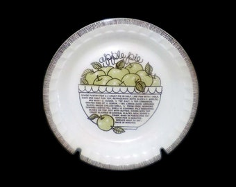 Vintage (1980s) Royal China   Jeannette Apple Pie recipe pie plate. Crimped sides, Apple Pie recipe in center. Made in USA.