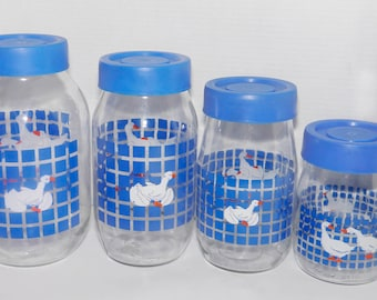 Set of four vintage (1980s) Carlton Glass white geese and blue checks canisters with removable blue plastic lids. Retro kitchen decor.
