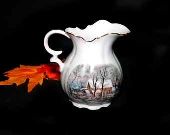 Vintage (1977) Avon Currier & Ives Christmas pitcher made in Japan. Gold edge, accents.