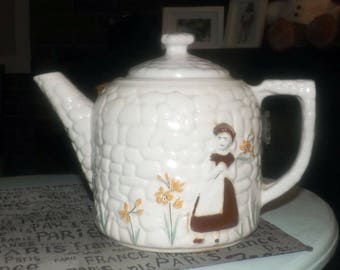 Early mid-century (early 1940s) Porcelier USA Cobblestone pattern hand-decorated teapot.  Girl against wall with flowers.