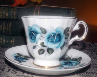 Vintage (1960s) Royal Grafton blue roses tea set (footed cup with matching saucer). Gold edge and accents.