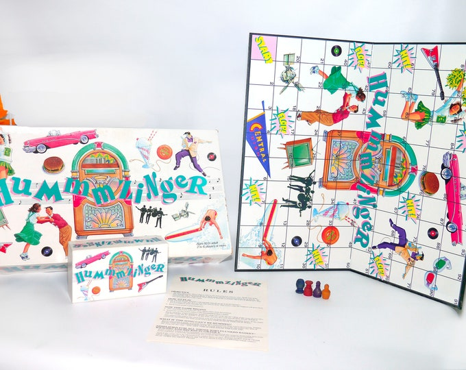 Vintage (1989) Hummmzinger Rock 'n' Roll board game. Music of the '50s thru 80s. Big Game Hunters Canada Games. Almost complete (see below).