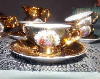 Mid-century (1950s) Genex Japan gold lusterware demitasse espresso | cappuccino set.  French romance | courting scene.  Hand-painted.
