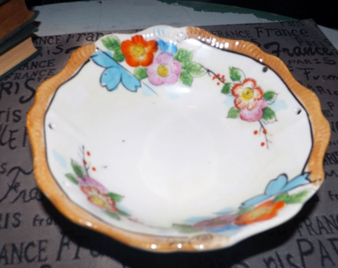Early mid-century (late 1940s) Nippon Japan hand-painted bowl.  Bold orange, pink, blue florals, mustard luster edge, white ground.