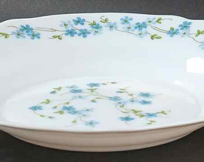 Vintage (1980s) Arcopal France Veronica pattern milk glass rimmed soup, cereal, salad bowl with blue florals.