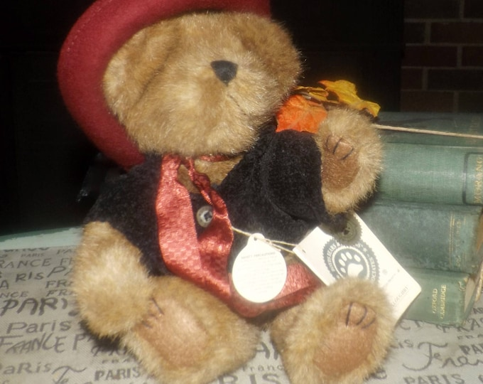 Vintage (mid 1990s) Boyd's Bear plush teddy bear in red brimmed felt hat and ribbon and black, knitted jacket with buttons.  Original tags.