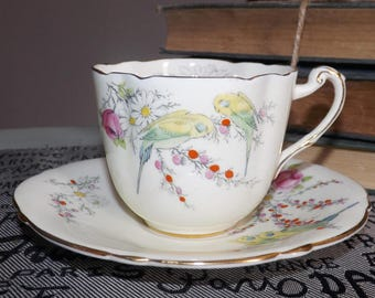 Quite vintage (1930s) Paragon Princess Margaret Rose hand-decorated tea set (flat cup with oval saucer).  Birds, flowers, gold.
