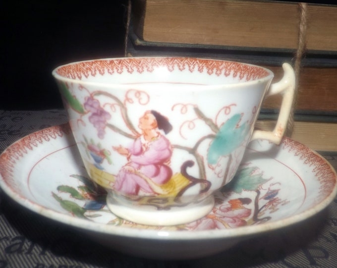 Antique (1800s) Qing Dynasty Chinese Famille Verte hand-painted tea set (flat cup with saucer). Oriental people, garden, grapes, red rim.