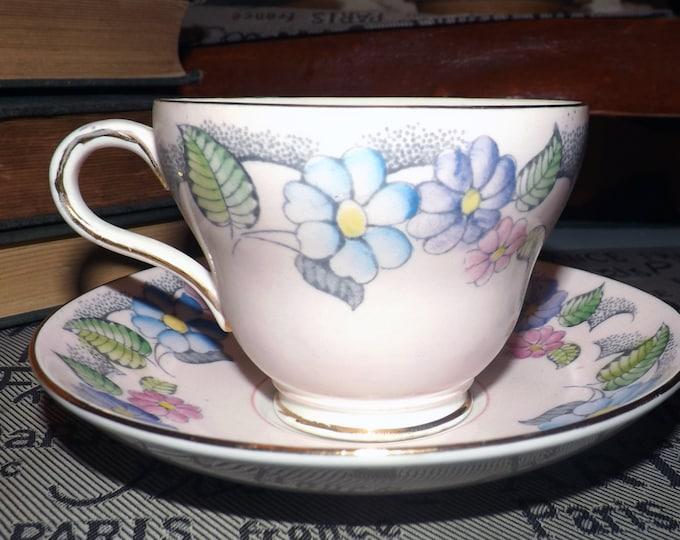 Quite vintage (1930s) Foley hand-decorated tea set. Multicolor florals, gold edge, accents marked V272.