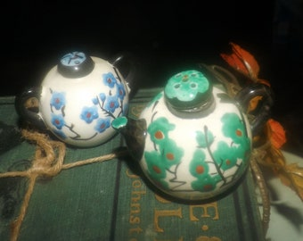 Early mid-century (1940s) Nippon novelty salt and pepper shakers. Teapot and sugar bowl. Hand-painted, made in Japan. Green, blue flowers.