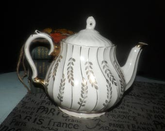 Early mid-century (1940s) Sadler England pattern 2959 large, hand-decorated teapot. Golden leaves and swirls on cream. Flawed (see below).