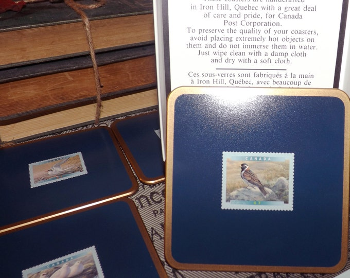 Set of 4 (1994) Canadiana The Birds of Canada coasters. First release stamps based on the artwork of John James Audubon.