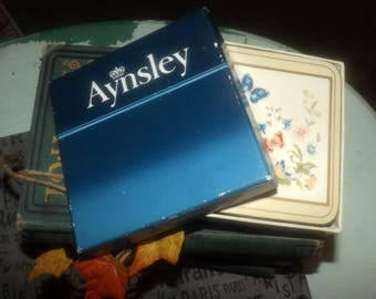 Set of 6 vintage (1980s) boxed Aynsley England Cottage Garden pattern square acrylic cork-backed coasters.  Flowers, butterflies.