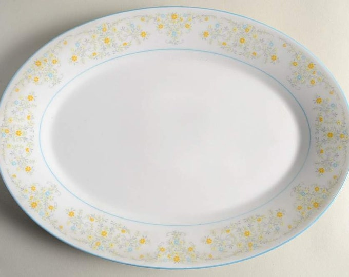 Vintage (1970s) Noritake Epic pattern 2680 oval vegetable serving platter.  Gently embossed blue, yellow flowers, blue edge and band.