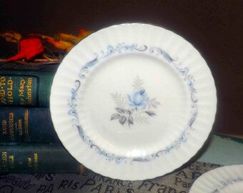 Vintage (1960s) Paragon Morning Rose bread-and-butter, dessert, or side plate.  Blue roses, grey leaves, grey scrolls and a platinum edge.