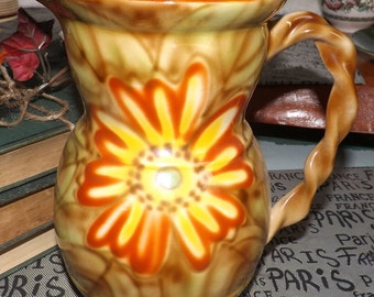 Early mid-century (1940s) Royal Art Pottery pitcher, jug or vase. Tones of red, brown, yellow, central florals branch-look handle. England.