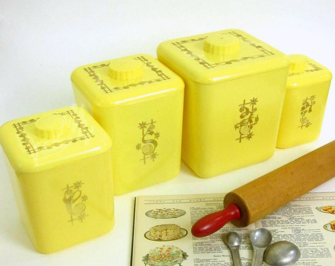 Mid-century (1950s) set of 4 Lustro Ware retro plastic canisters. Sugar, Coffee, Tea, Flour. Sunny yellow, gold lettering.