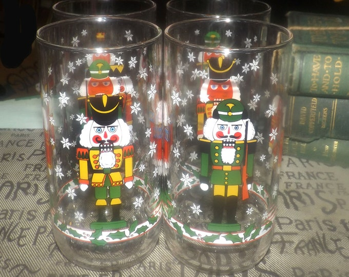 Set of vintage (1980s) Libbey Glass Christmas glasses | tumblers.  Etched-glass Nutcracker imagery, snowflakes, holly, berries.