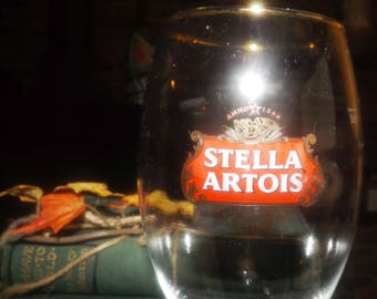Stella Artois footed goblet | stemmed beer glass.  Etched glass logo, professional dispensing mark at 50cl on reverse. Raised logo near base