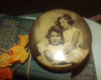 Quite vintage (late 1930s) Riley's round toffee tin featuring a black-and-white image of the Royal Princesses, Elizabeth and Margaret.