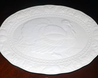 Vintage (1970s) all-white JAP22 large, ceramic turkey platter. Central image of His Majesty, the turkey. Embossed fruit, veggies. Japan.