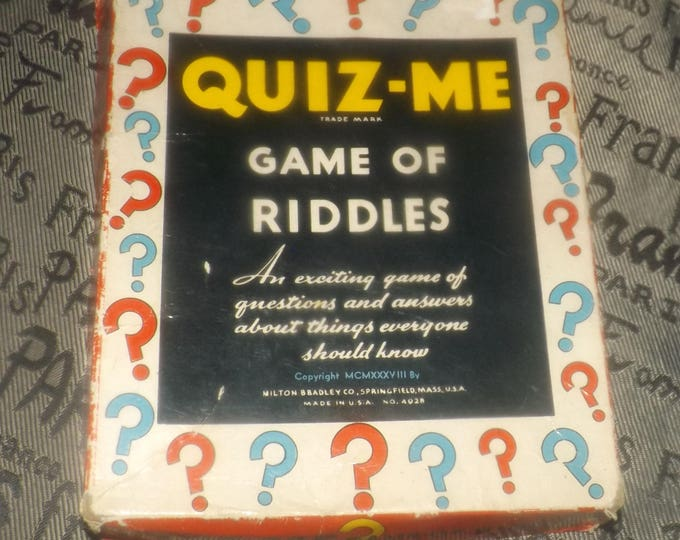 Quite vintage (1938) Quiz-Me Game of Riddles published by Milton Bradley.  Made in the USA. Game No. 4928.