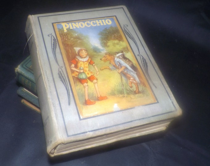 Almost antique (1924) Pinocchio illustrated children's book by D. Collodi. Illustrated Frances Brundage. Saalfield Publishing USA.