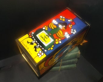 Vintage (1990) Romero Britto lithographed Creme de Grand Marnier tin signed by the artist. Hinged lid.  Fun pop art retro bar decor.