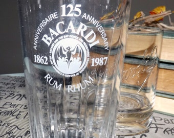 Pair of vintage (1980s) Bacardi glasses: tumbler w/etched white logo,  lo-ball | whisky | on-the-rocks glass w/raised logo and bat emblem.