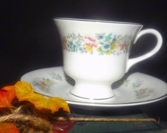 Vintage (1970s) Wedgwood Aspen R4542 tea set (footed cup with matching saucer). Multicolor florals, platinum edge.