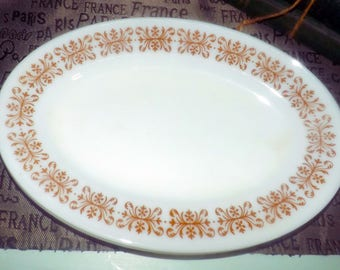 Vintage (1970s) Pyrex   Corning PYR3 pattern oval vegetable   serving platter.  Brown   copper scrolls and flowers on white. Made in USA.
