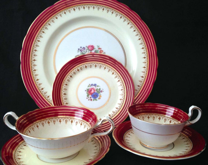 Featured listing image: Quite vintage (1930s) Aynsley Dorchester Maroon 7499 one 7-piece place setting. Pink roses, center florals, maroon rim, gold edge.