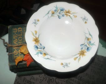 Vintage (1970s) Cmielow rimmed soup | salad bowl. Blue, yellow flowers, scalloped, gold edge. Made in Poland.