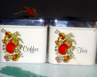 Pair of vintage (1960s) Cheinco USA Spice of Life pattern metal tea and coffee canisters with lids. Vegetable imagery, chrome lids.