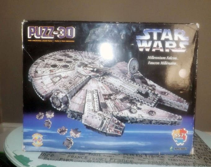 Vintage (1995) Wrebbit 3-D Foam Puzzle of the Star Wars Millennium Falcon. Complete with box and instructions.
