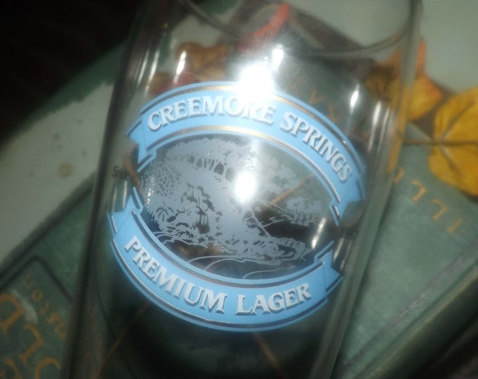 Vintage (mid 1990s) Creemore Springs Premium Lager pint glass. Etched-glass branding, weighted base.