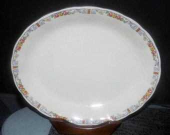 Early mid-century (1940s) Grindley Carmona-like oval platter. Multicolor florals, mustard rings. Cream Petal Ironstone. Similar to Carmona.