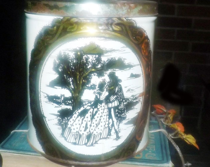 Early mid-century (1940s) biscuit tin for tea caddy or canister. Lithographed romance scene detailed scrollwork.  Likely made in England.