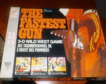 Vintage (1974) The Fastest Gun 3D Wild West Shoot-Out board game published in Canada by Milton Bradley. Complete.