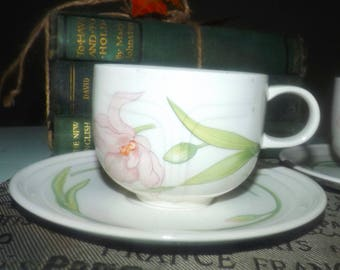 Vintage (1980s) Johnson Brothers Celebrity pattern tea set (flat cup with saucer). Pink iris blooms, greenery, embossed perimeter details.