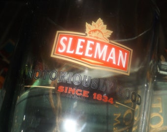 Vintage (early 1990s) Sleeman Notoriously Good Since 1834 heavy glass beer stein.  Etched-glass branding.
