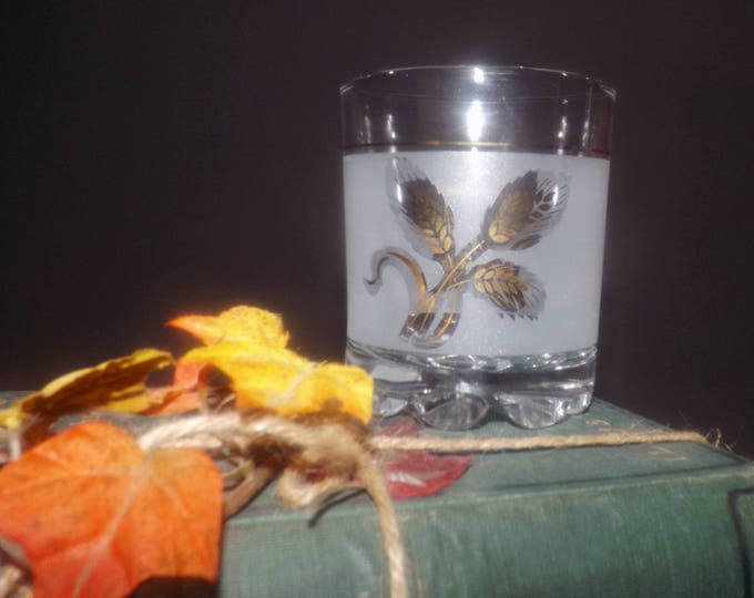 Late mid-century (1950s) Covetro whisky   lo ball glass. Etched golden leaves, frosted panels, weighted base. Made in Italy.