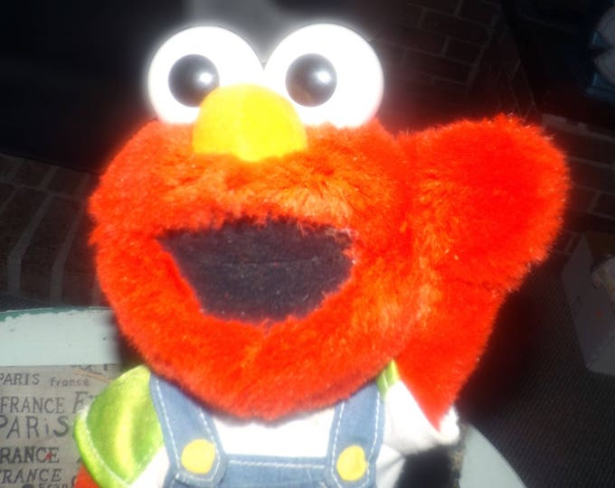 Vintage (1998) Let's Pretend Elmo interactive toy published by Sesame Street and Mattel.