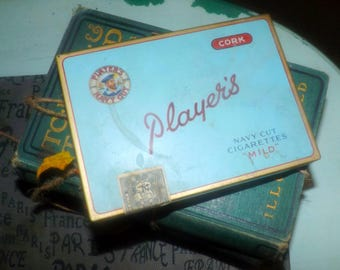 Vintage (1960s) Player's Cigarettes Navy-Cut, cork-tipped hinged-lid tin. Original tax   excise label. Imperial Tobacco Montreal.