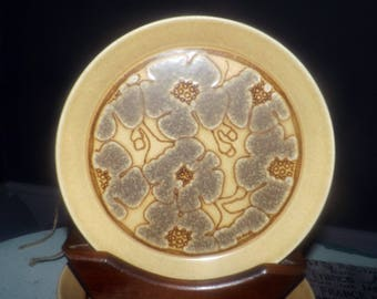 Vintage (1970s) Crown Lynn New Zealand Camille D627 salad or side plate. Embossed center florals. Earthstone stoneware.