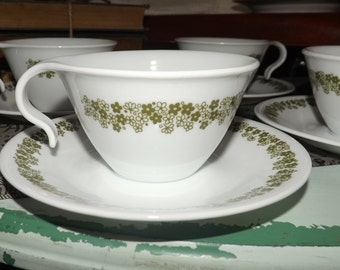 Vintage (1970s) Corelle Corning Spring Blossom tea set (hangable cup with matching saucer).  Green florals on white ground.